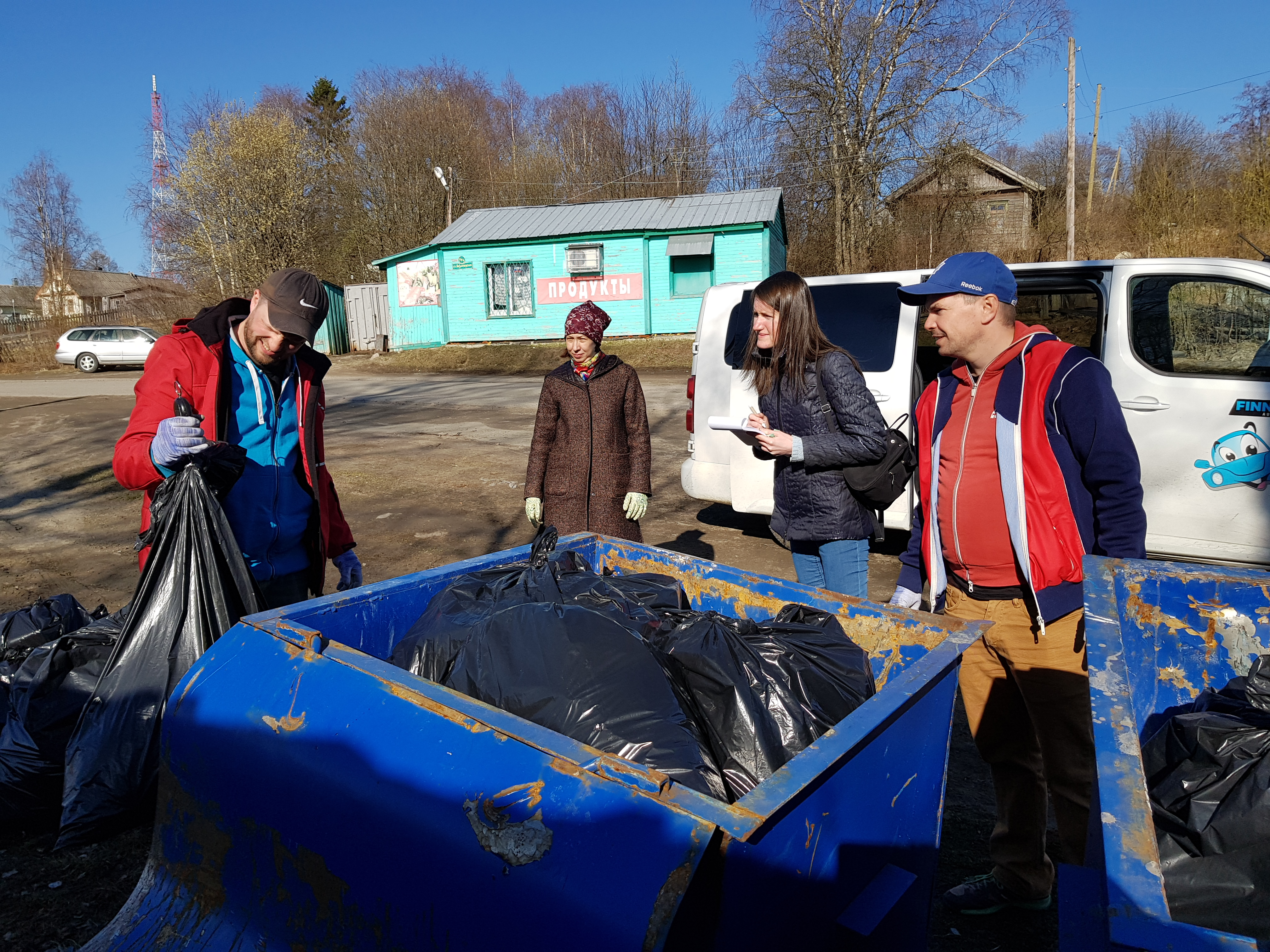 Measuring collected waste in Vedlozero, Russia